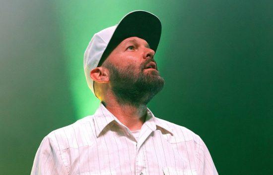 Fred Durst of Limp Bizkit wearing a white baseball cap.